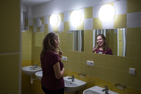 Ieva in one of Větrník's renovated bathrooms. Photo: René Volfík.